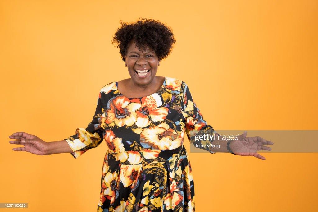 Informal portrait of early 60s black woman full of vitality : Stock Photo