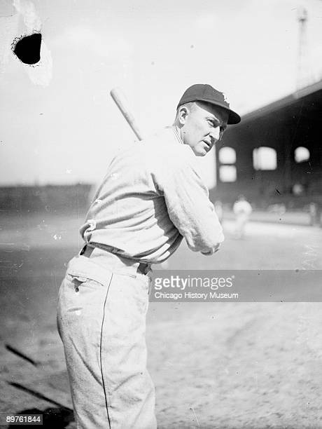Informal portrait of Hall of Fame baseball player Ty Cobb of the American League's Detroit Tigers holding a baseball bat standing in a batting stance...