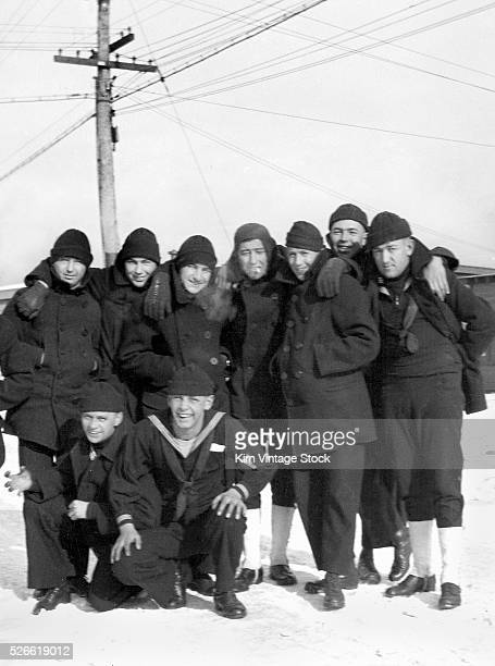 Informal portrait of navy recruits on the snowy grounds of Great Lakes Naval Training Station in North Chicago Illinois