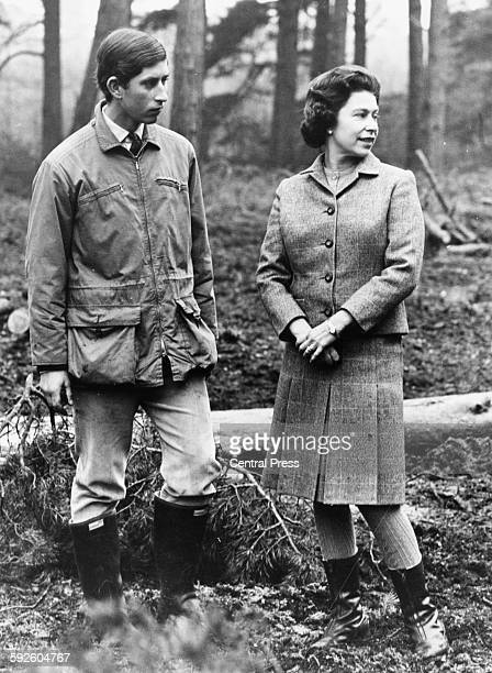 Informal portrait of Prince Charles and his mother, Queen Elizabeth II, strolling through the woods of their estate at Sandringham, Scotland, April...