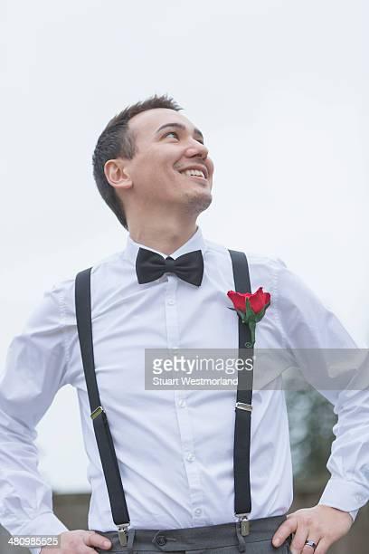 Informal portrait of smiling groom at wedding