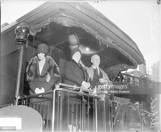 Informal three-quarter length portrait of Alfred E. Smith, Governor of New York from 1919-1921 and 1923-1929, waving his hat and standing on the rear...