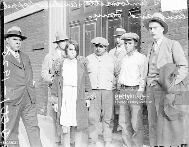 Informal threequarter length portrait of Antoinette Andrew and Anthony Cappellano involved in the Ranieri case standing with four unidentified men in...