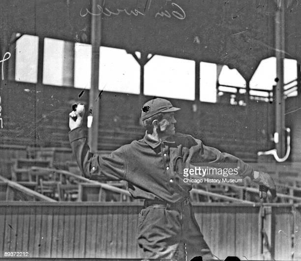 Informal three-quarter length portrait of baseball player B. Ewing of the National League's Cincinnati baseball team, cocking his arm to throw a...