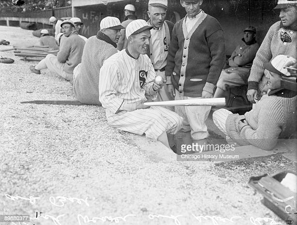 Informal three-quarter length portrait of baseball player Buck Weaver of the American League's Chicago White Sox, holding a silver baseball and a...