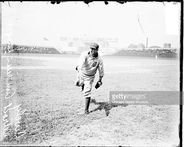Informal threequarter length portrait of baseball player Jack Lively pitcher for the American League's Detroit Tigers following through after...