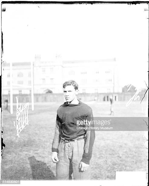 Informal threequarter length portrait of University of Chicago football player Kuh standing on the field at Marshall Field on the University of...