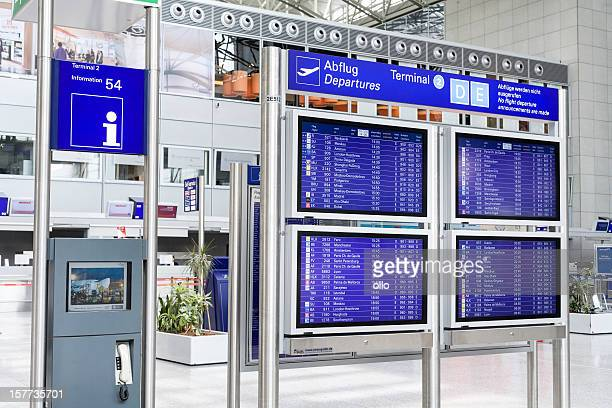 Information desk and departure timetable at the airport