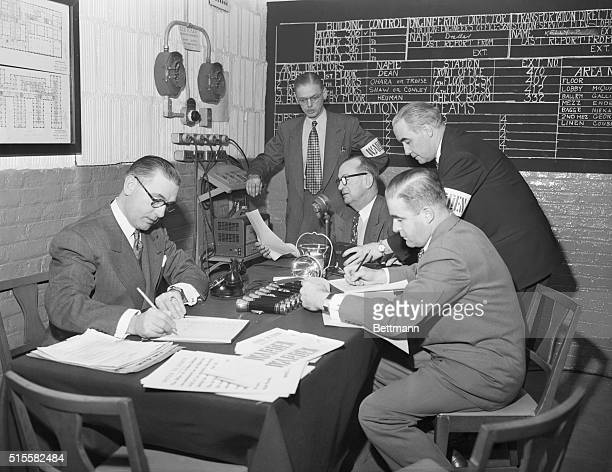 Information flows through this air raid control room at the Hotel Statler during a comprehensive air raid drill