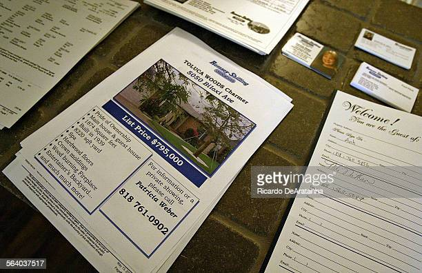 Information flyers business cards and log book on the kitchen counter of an open house on the 5000 block of Biloxi Av Photo to illustrate a Real...