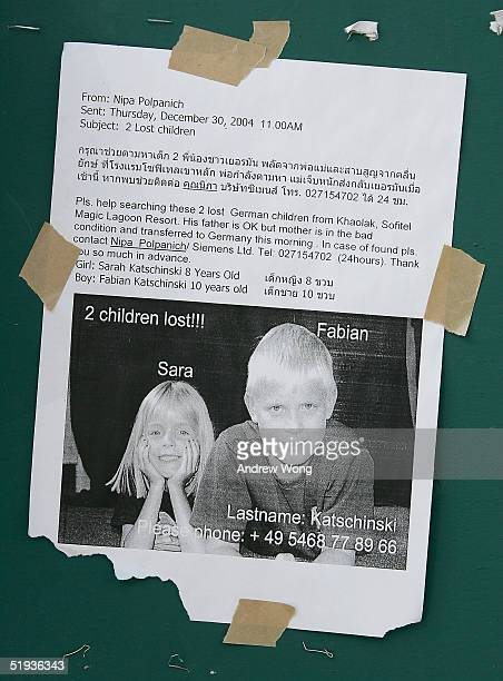Information of missing western tourists is posted on a notice board at the main relief center on January 11 2005 in Phuket Thailand At least 150754...