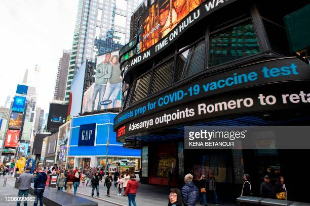 Information related to coronavirus is displayed on a screen in Times Square on March 8 2020 in New York City The governor of New York on March 7 2020...