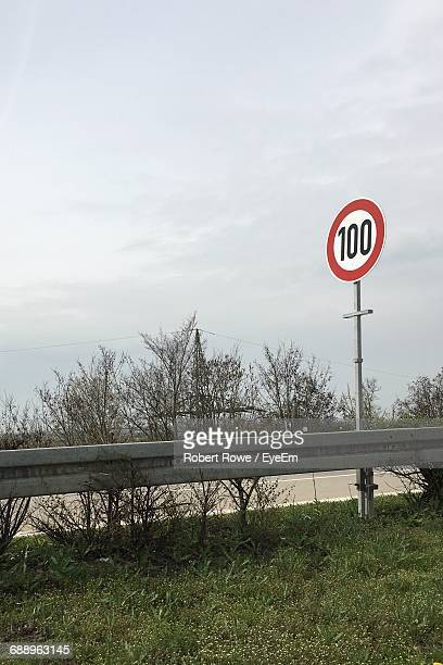 information sign against sky - speed limit sign stock photos and pictures