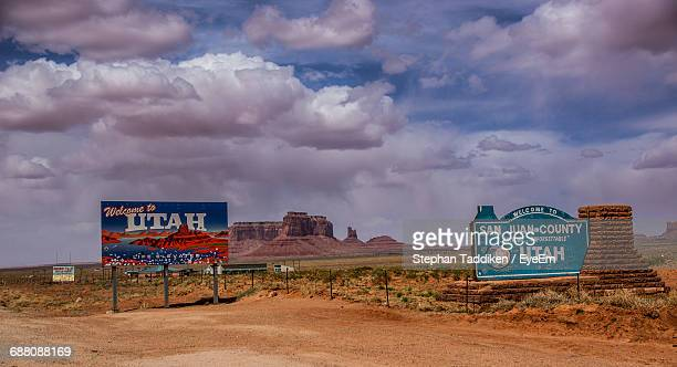 information sign at monument valley against sky - utah stock pictures, royalty-free photos & images