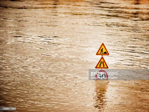 information sign by lake - flooding stock photos and pictures