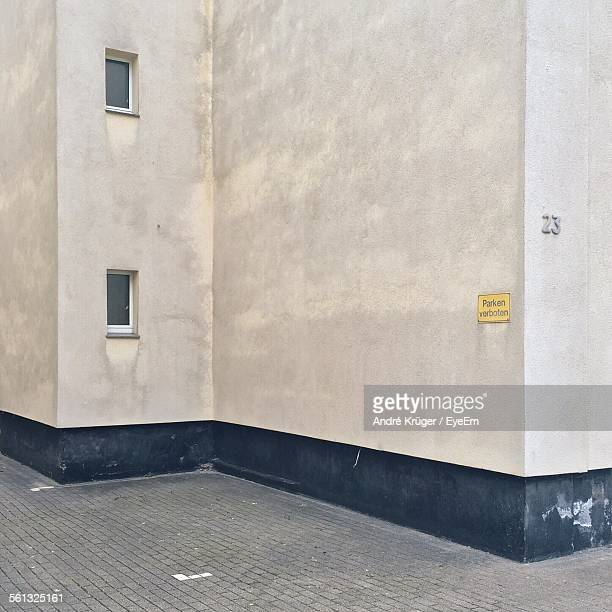 information sign on building wall - dortmund stock pictures, royalty-free photos & images