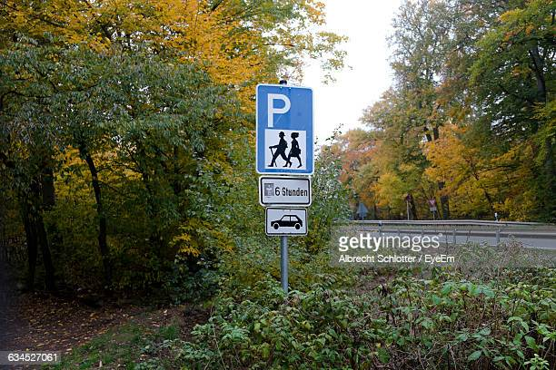 information sign on field against trees during autumn - albrecht schlotter stock photos and pictures