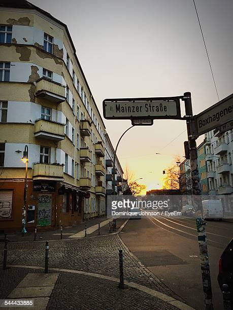 information sign on street by buildings in city during sunset - johnson stockfoto's en -beelden
