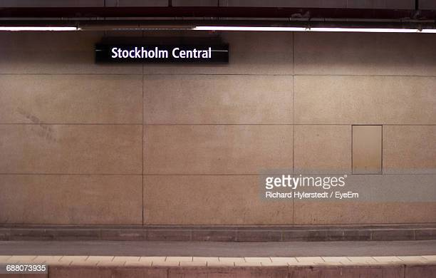 information sign on wall at illuminated stockholm central station - railway station stock pictures, royalty-free photos & images