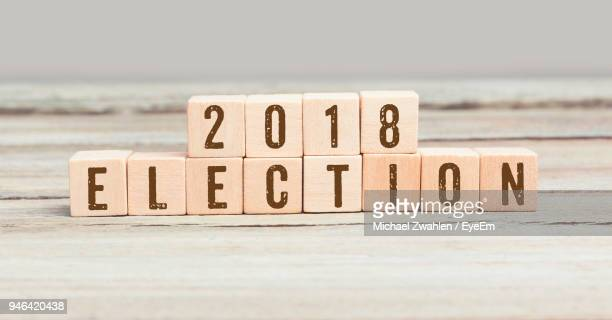 information sign on wood against white background - election stock pictures, royalty-free photos & images
