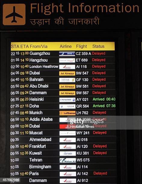 Information signage board displaying delayed passengers flights at T3 Terminal Airport at the Indira Gandhi Airport on December 18 2013 in New Delhi...
