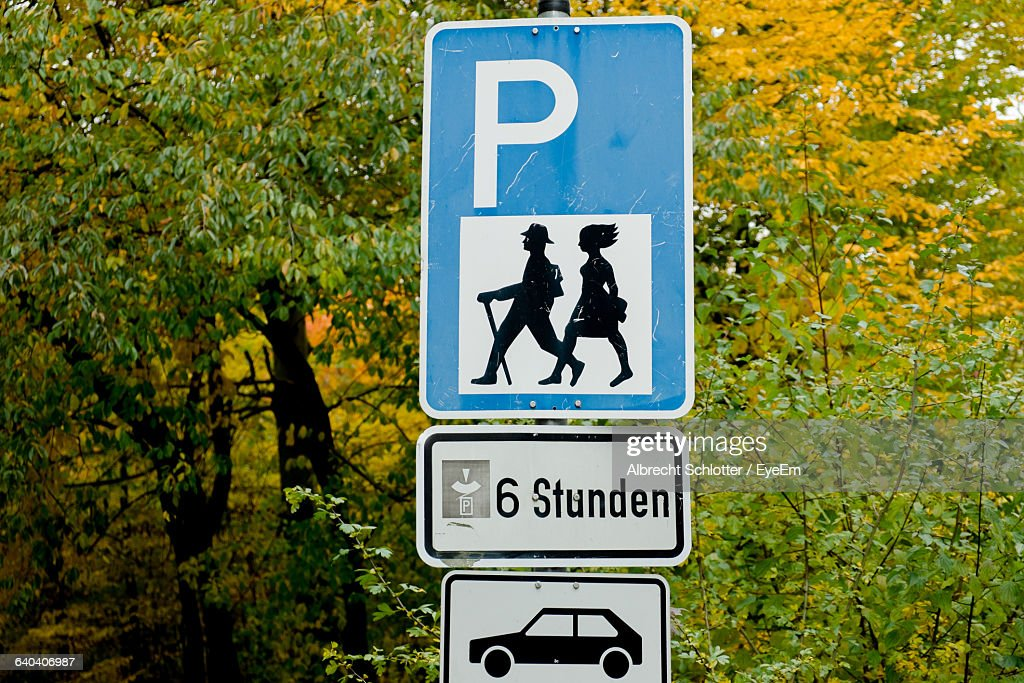 Information Signs Against Trees During Autumn : Stock-Foto