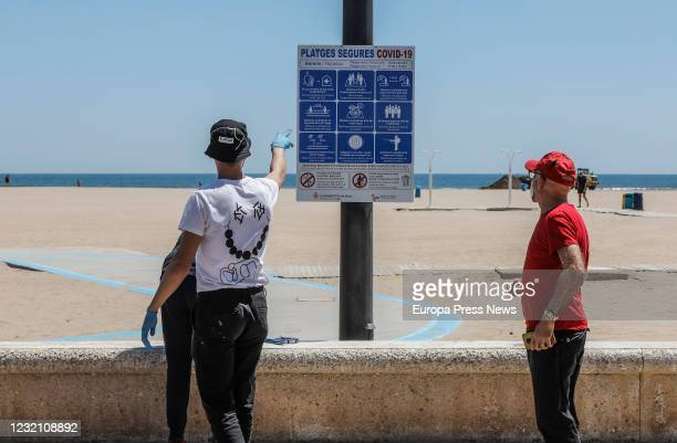 Information signs on Malvarrosa beach about safety measures on the occasion of the entry into Phase 2 of the Community of Valencia in which bathing...
