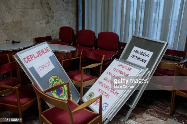 Informative signs used in a campaign for vaccinations and for mass testing for COVID-19 lie on the ground on February 11, 2021 in Kranj, Slovenia....