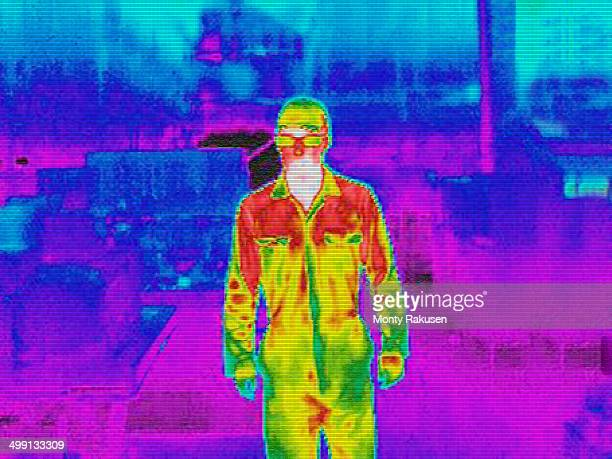 Infra red heat image of worker in factory