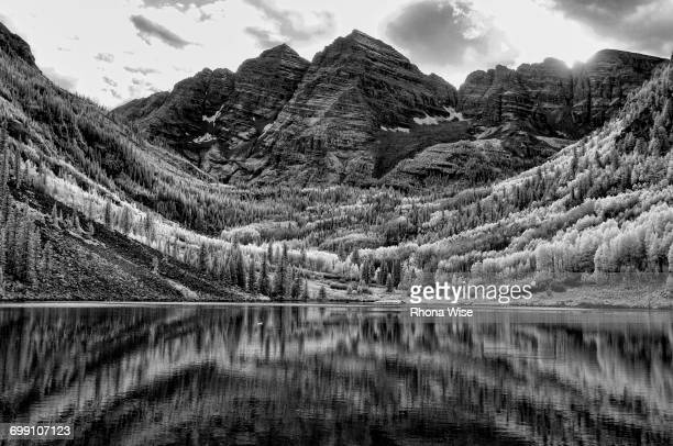 infrared image of the maroon bells - maroon bells stock photos and pictures