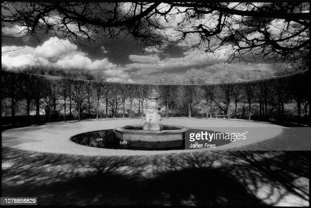 Infrared photo of a fountain surrounded by a ring of trees in the Georgetown neighborhood's Dumbarton Oaks Park, Washington DC, April 1988.