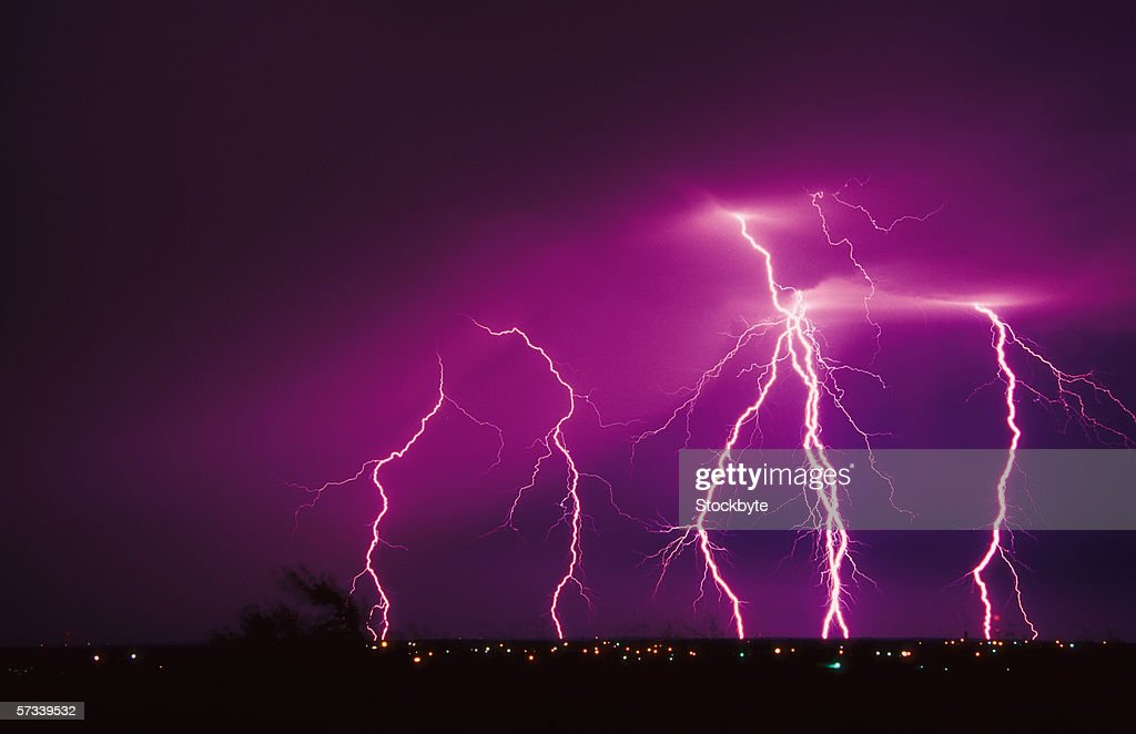 infrared shot of a bolt of lightning hitting the ground stock photo