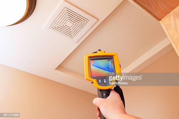 Infrared Thermal Imaging Camera Pointing to Attic Access