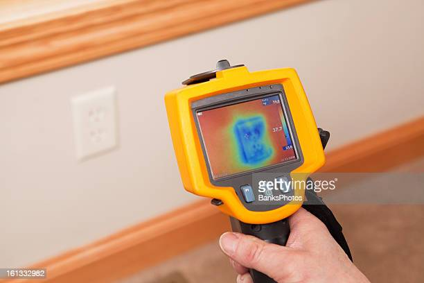 Infrared Thermal Imaging Camera Pointing to Wall Outlet