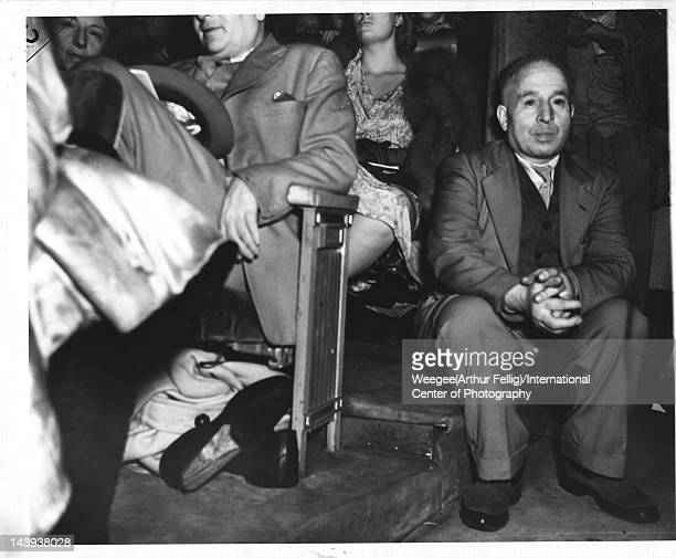 Infrared view of a a man as he sits in the aisle of a crowded movie theater twentieth century Photo by Weegee /International Center of...