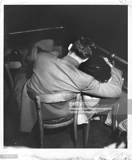 Infrared view of a couple as they embrace seated side by side in a movie theater twentieth century Photo by Weegee /International Center of...