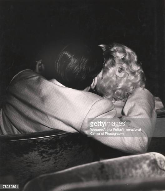 Infrared view of a couple at a movie theatre New York New York early 1940s Photo by Weegee/International Center of Photography/Getty Images