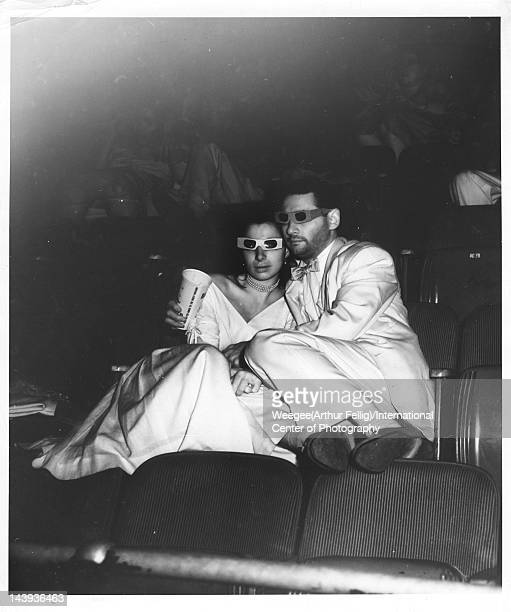 Infrared view of a couple in 3D glasses as they embrace seated side by side in a movie theater twentieth century Photo by Weegee /International...