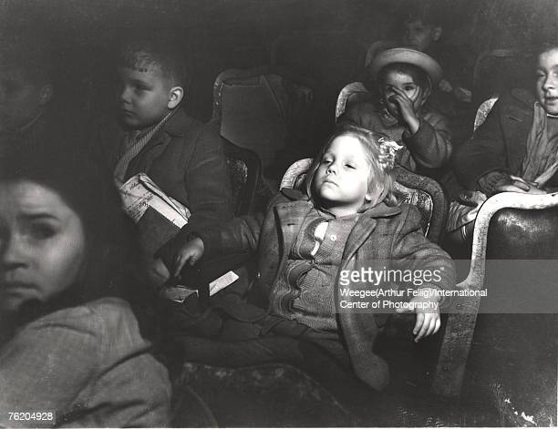 Infrared view of a theatre full of children as they watch a movie, New York, New York, early 1940s.
