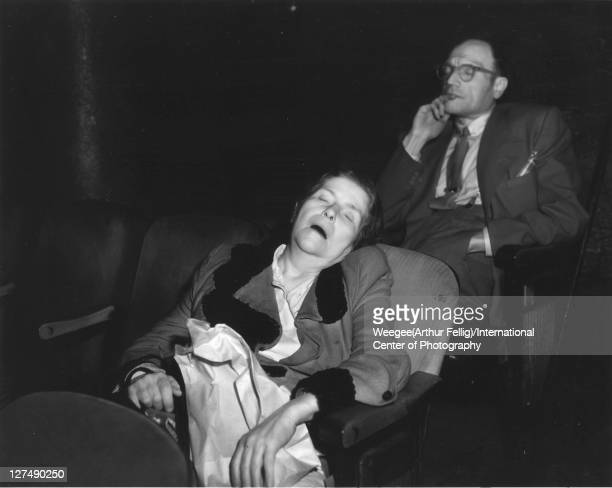 Infrared view of a woman asleep in a movie theatre New York New York mid 20th century The man behind her also has his eyes closed Photo by...
