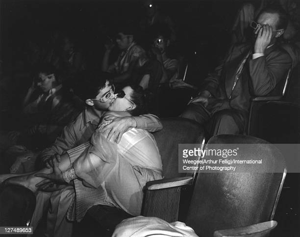 Infrared view of a young couple as they kiss in the audience of a 3D movie New York New York early to mid 1940s Photo by Weegee/International Center...