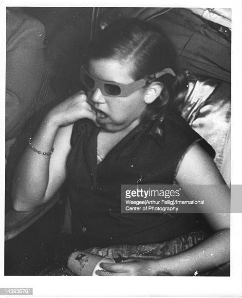 Infrared view of a young woman with 3D glasses as she watches a movie twentieth century Photo by Weegee /International Center of Photography/Getty...