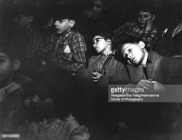 Infrared view of children as they watch a movie in a darkened cinema New York New York 1940s Photo by Weegee/International Center of...