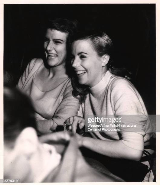 Infrared view of two young women who laugh while they watch a movie in a theatre New York New York early 1940s Photo by Weegee /International Center...