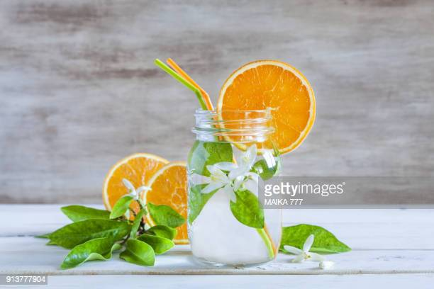 infused orange flower water or orange blossom water - orange blossom stock photos and pictures