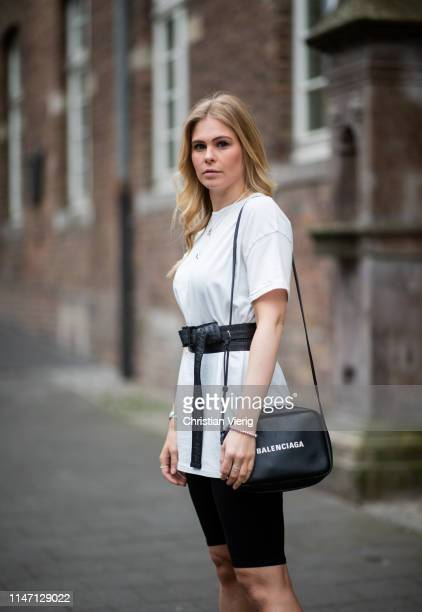 Inga Brauer is seen wearing black cylce pants white shirt Stradivarius Balenciaga bag Off White belt on May 04 2019 in Duesseldorf Germany