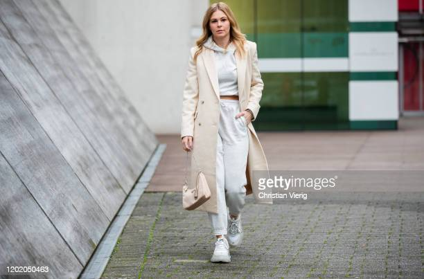 Inga Brauer is seen wearing grey cropped hoody and jogger pants H&M, creme white coat &other stories, Triple S sneaker Balenciaga, beige bag Prada...