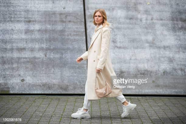 Inga Brauer is seen wearing grey cropped hoody and jogger pants H&M, creme white coat &other stories, Triple S sneaker Balenciaga, beige bag Prada...
