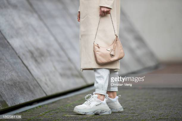Inga Brauer is seen wearing grey jogger pants H&M, creme white coat &other stories, Triple S sneaker Balenciaga, beige bag Prada mulit-pochette...