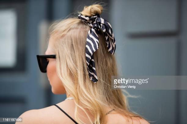 Inga Brauer is seen wearing silk top Asos, H&M hairband on July 06, 2019 in Berlin, Germany.